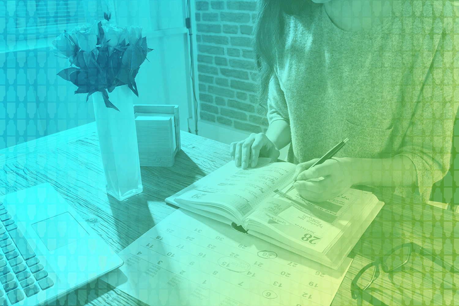 color-treated photo of a person working in a planner