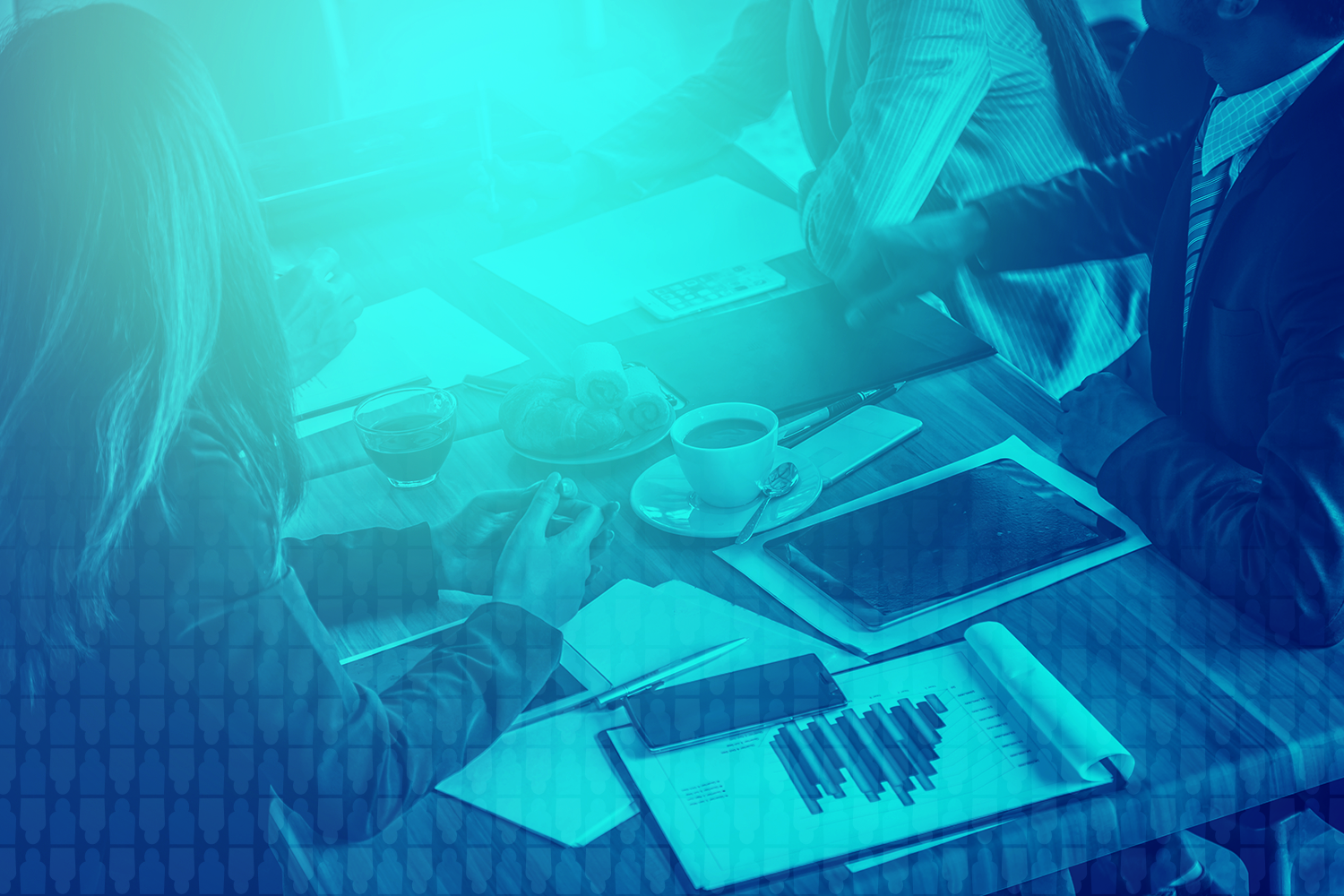 color-treated image of a group of business people discussing strategy over coffee at a table with devices and charts